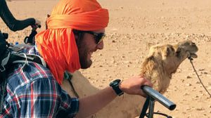 Tillmon Cook riding a camel